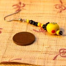 Glass bug earrings, black and yellow – $10