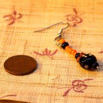 Glass bug earrings, black and orange – $10