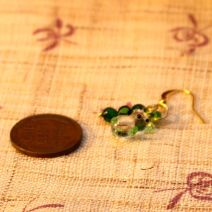 Tiny green glass teddy bear earrings – $6