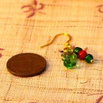 Tiny glass Christmas frog earrings – $6