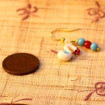 Tiny glass swan earrings – $6