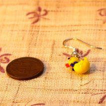 Tiny glass rubber ducky earrings – $4