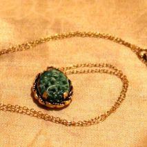 Carved jade in elegant setting $35